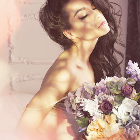 fragrant: Fashion art photo of beautiful lady with flowers. Home interior. Morning