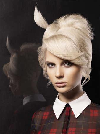hairdo: Studio portrait of beautiful lady with fashion hairstyle