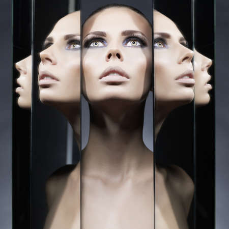 nude girl: Fashion studio portrait of woman and mirrors on black background