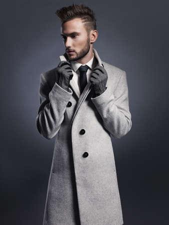 forceful: Portrait of handsome stylish man in elegant autumn coat