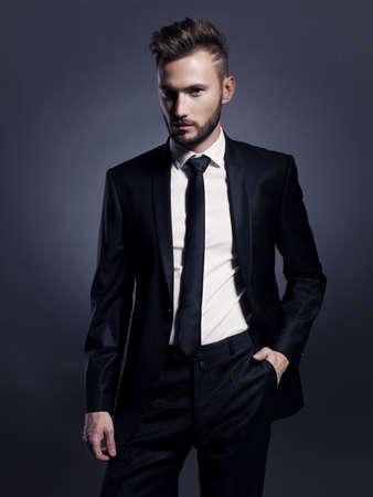 handsome: Portrait of handsome stylish man in elegant black suit