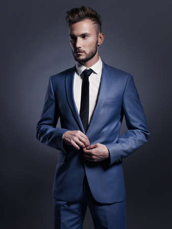 Portrait of handsome stylish man in elegant blue suit