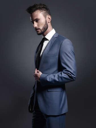 forceful: Portrait of handsome stylish man in elegant blue suit