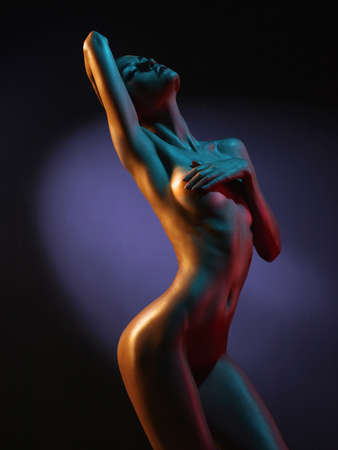nude fashion model: fashion art photo of elegant nude model in the light colored spotlights