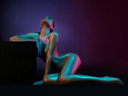 nude lady: fashion art photo of elegant nude model in the light colored spotlights
