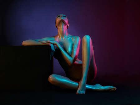 fashion art photo of elegant model in the light colored spotlights