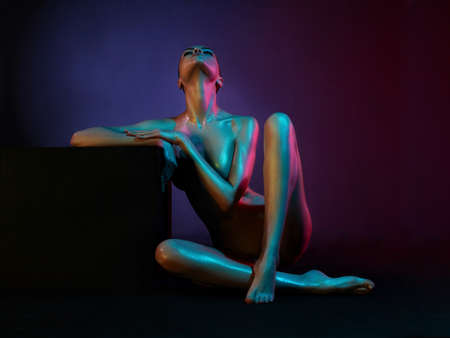 nude model: fashion art photo of elegant nude model in the light colored spotlights