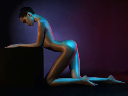 nude art model: fashion art photo of elegant nude model in the light colored spotlights