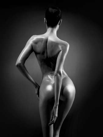 nude pose: fashion art photo of elegant nude model in the light colored spotlights