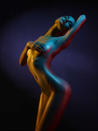 nude female figure: fashion art photo of elegant nude model in the light colored spotlights