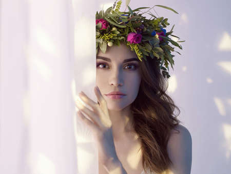 Fashion art photo of beautiful lady in flower diadem. Spring/Summer Stock Photo