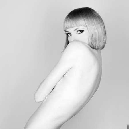 Beautiful flexible redhead girl with a bob haircut photo