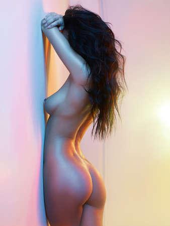 Fashion art studio photo of elegant nude woman in luminous interior Stock Photo