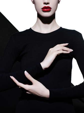 Fashion art studio portrait of elegant blode in geometric black and white background 스톡 콘텐츠
