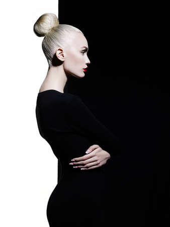 Fashion art studio portrait of elegant blode in geometric black and white background Stok Fotoğraf
