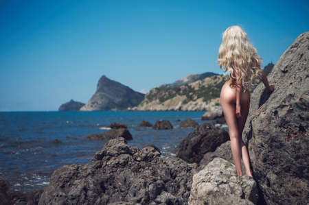 nude sexy woman: Portrait of beautiful  nude blonde on the nudist beach Stock Photo