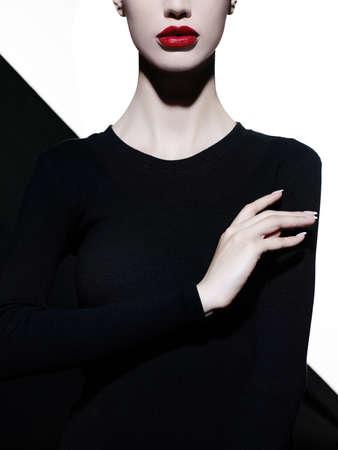 posing: Fashion art studio portrait of elegant blode in geometric black and white background Stock Photo