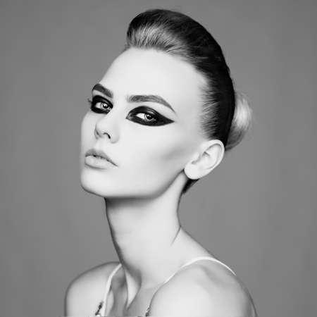 smoky black: black and white studio photo of elegant lady with smoky eyes makeup.