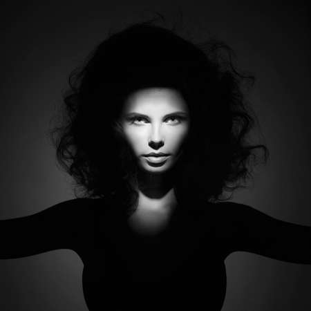 hair studio: Black and white studio fashion portrait of beautiful woman with volume wavy hair. Big hair Stock Photo