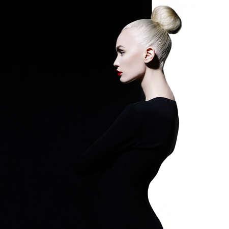 Fashion art studio portrait of elegant blonde in geometric black and white background