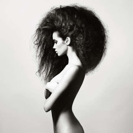 Portrait of sensual woman with magnificent bushy hair photo