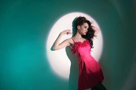 sexy girl dance: Studio art fashion photo of beautiful sexy yong woman in beam of searchlight
