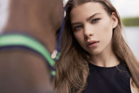 Outdoor art fashion photo of beautiful young lady with horse. Stock Photo