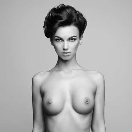 Black and white fashion photo of nude elegant woman with elegant hairstyle. Health and beauty Standard-Bild