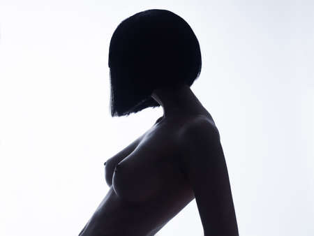 Black and white fashion photo of nude elegant woman with short haircut. Brunette bob hairstyle. Fashion, Health and beauty