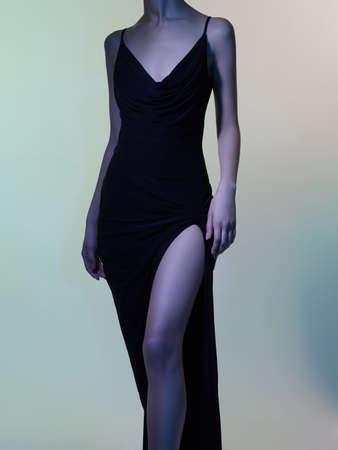 Fashion studio portrait of beautiful woman in black dress on colorful background. Asian beauty.