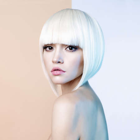 Art fashion studio portrait of beautiful blonde with short haircut