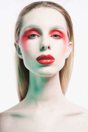 Studio portrait of sexy lady with blonde hair. Woman posing with colorful lipstick. Beautiful girl with bright makeup. Portrait with mirrrors.