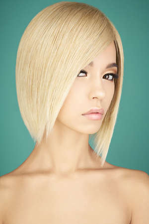 Fashion studio portrait of lovely asian woman with blonde short hair. Fashion and beauty. Bright makeup. Fashionable haircut. Sexy young model with beautiful eyes Stock Photo - 118643169