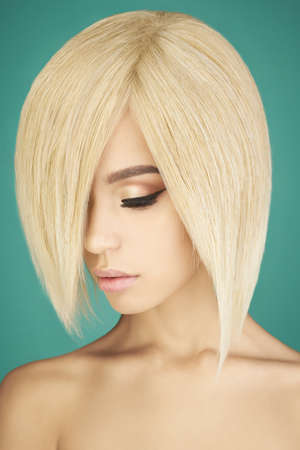 Fashion studio portrait of lovely asian woman with blonde short hair. Fashion and beauty. Bright makeup. Fashionable haircut. Sexy young model with beautiful eyes Stock Photo