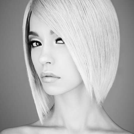 Fashion studio portrait of lovely asian woman with blonde short hair. Fashion and beauty. Bright makeup. Fashionable haircut. Sexy young model with beautiful eyes Stock Photo - 121423782
