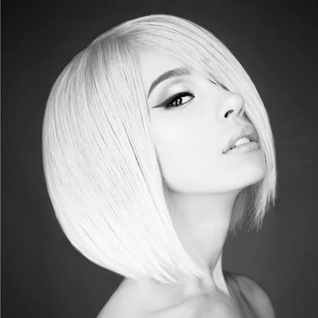 Fashion studio portrait of lovely asian woman with blonde short hair. Fashion and beauty. Bright makeup. Fashionable haircut. Sexy young model with beautiful eyes Foto de archivo