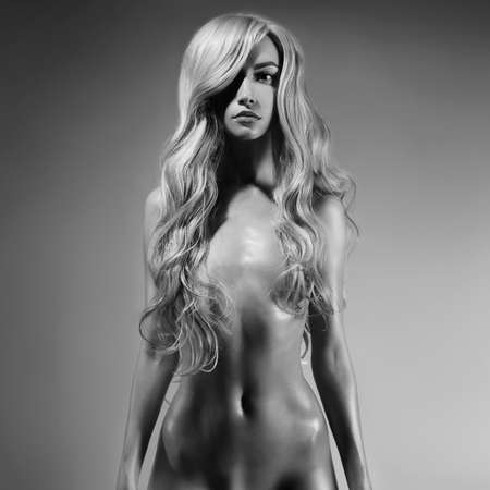 Nude beautiful blonde dancing. Erotic portrait of sexy woman with long hairs. Sexual naked model pose background. Perfect female body of elegant stripper. Pretty girl.