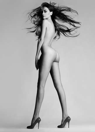 beautiful nude lady with perfect body pose in black shoes. Conceptual fashion art photo