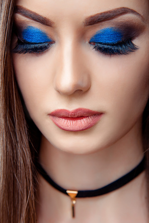 High fashion look close up beauty portrait of beautiful young woman model with bright makeup with perfect clean skin