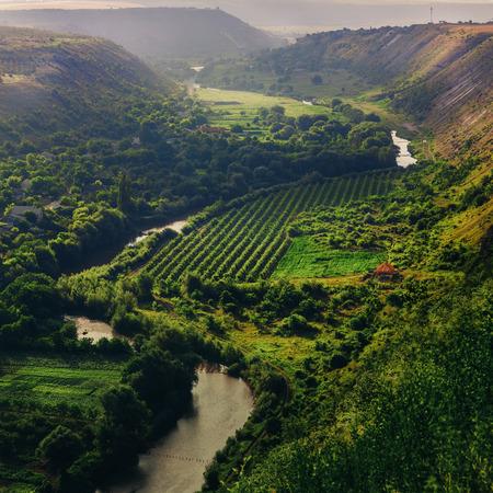 Scenic views, steep hills, the village, gardens and vineyards, Moldova.