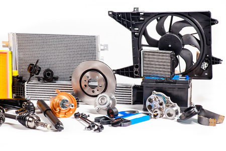 Unused new metallic parts for vehicle repair isolated on white. Stockfoto