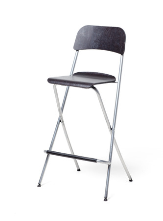 A chair on a white background. Isolated. Black chair with a high and thin legs metallic color. Archivio Fotografico