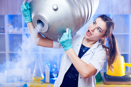 Excited woman holding metal gas container on shoulder in modern science lab.