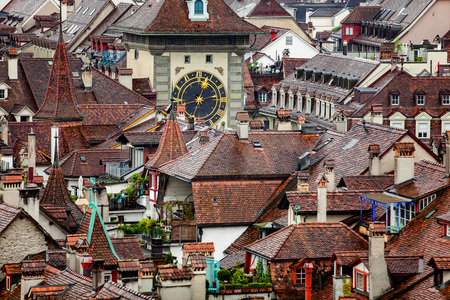 View to dark red roofs of historic town and clock tower in Bern, the capital of Switzerland