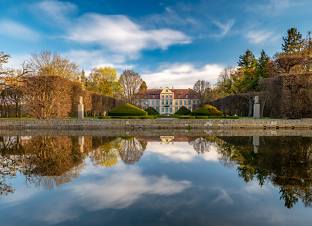 Abbots Palace in the rococo style and located in Oliwa Park. Early spring scenery. Gdansk, Poland.