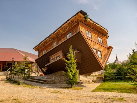 Szymbark, Poland - April 27, 2019: Natural size upside down house in Szymbark village.