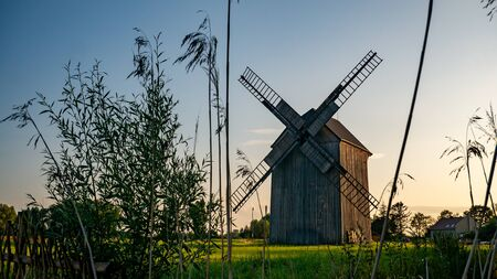 Old windmill on the green field. Banco de Imagens
