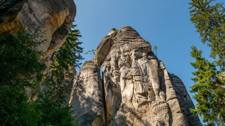 Climbers in rock town of Adrspach. Adrspach National Park in northeastern Bohemia, Czech Republic, Europe.