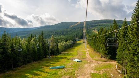 Summertime in the mountains where the ski lift allows for beautiful views. Karpacz, Kopa, Poland. Reklamní fotografie