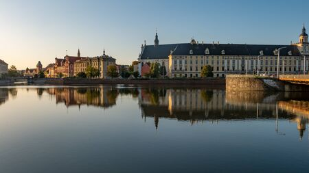View of University of Wroclaw, Odra River and University Bridge in Wroclaw at sunrise.